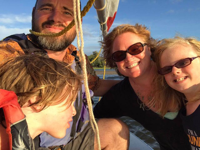 Adara and family on a boat